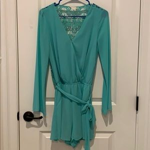 Long sleeved romper with lace back and pockets!